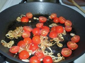 Shallots and tomatoes cooking